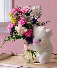 Includes a cuddly bear!