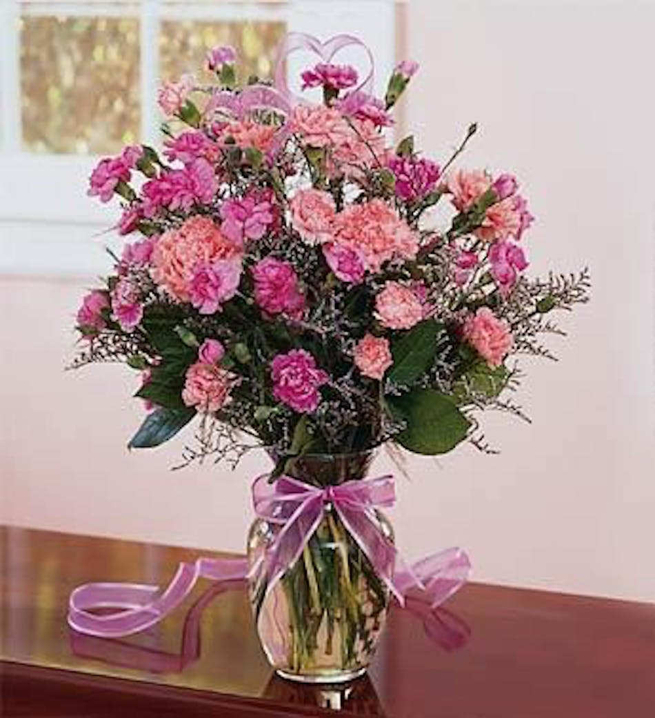 Pretty pink carnations in clear vase durocher florist wedding available for nationwide delivery izmirmasajfo