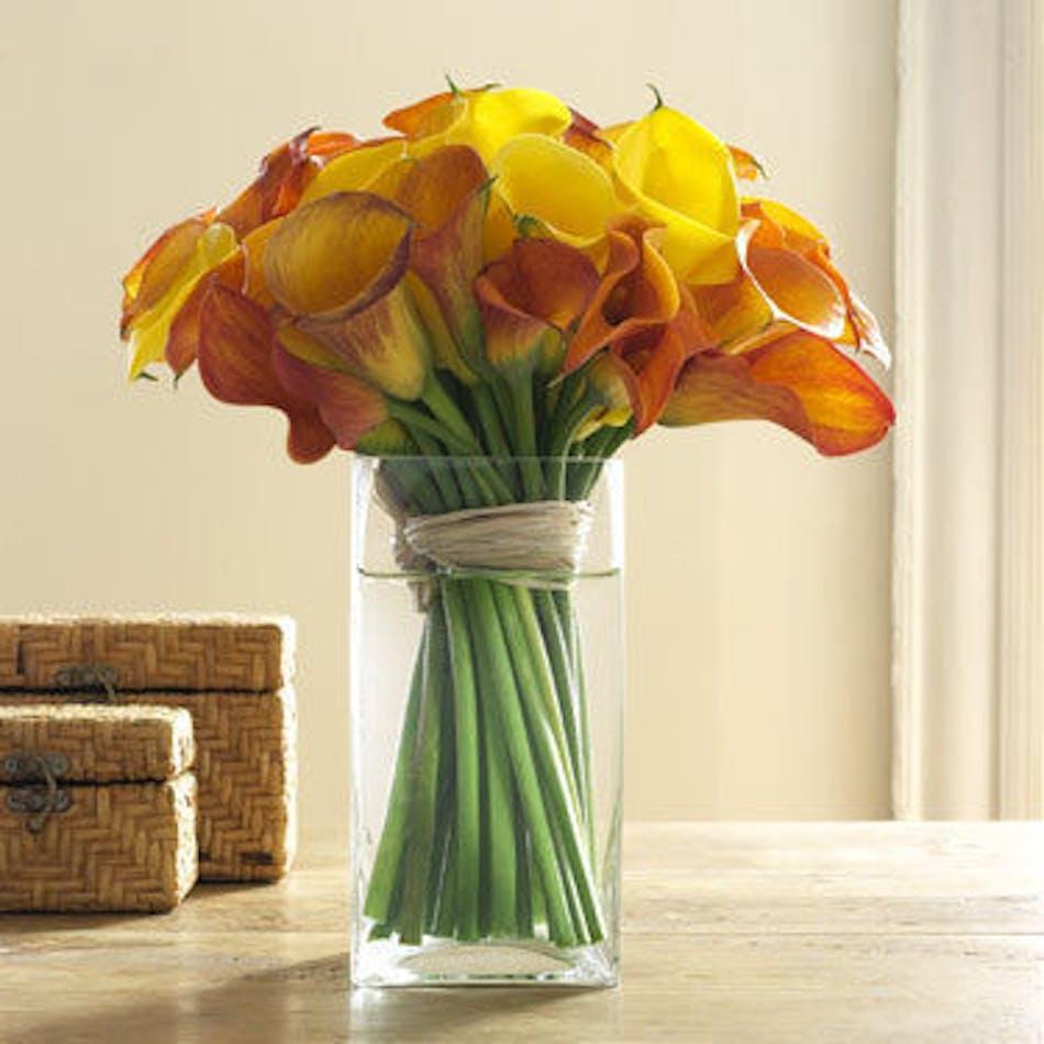 Mango calla lily bouquet durocher florist metropolitan designs available for nationwide delivery izmirmasajfo
